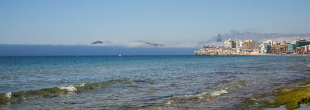 Amazing sea mist enveloping Benidorm and Poniente beach. Spain. Royalty Free Stock Photography