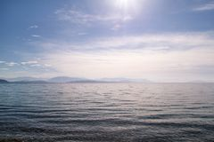 Amazing sea, sky, beautiful clouds and sun, majestic landscape with seascape at calm blue water on horizon of mediterranean coast. Natural environment. Summer stock photography
