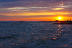 Amazing sea sunset on stony seashore Royalty Free Stock Photography