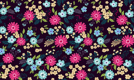 Amazing seamless floral pattern. With bright colorful flowers and leaves on a dark blue background. The elegant the template for fashion prints. Modern floral Royalty Free Stock Photos