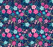 Amazing seamless floral pattern. With bright colorful flowers and leaves on a dark blue background. The elegant the template for fashion prints. Modern floral Stock Photos