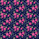 Amazing seamless floral pattern. With bright colorful flowers and roses on a navy blue background. The elegant the template for fashion prints. Modern floral Royalty Free Stock Photo