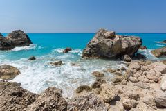 Seascape of blue waters and rocks of Megali Petra Beach, Lefkada, Ionian Islands, Greece royalty free stock image