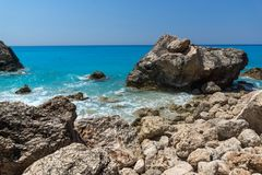 Seascape of blue waters and rocks of Megali Petra Beach, Lefkada, Ionian Islands, Greece royalty free stock images