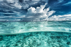 Amazing seascape. Dramatic cloudy sky, coral gardens under beautiful transparent water, beauty of nature, summer time concept stock image