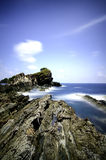 Amazing seascape of Kapas Island at Terengganu, Malaysia and wave hitting the cliff stone. Stock Image