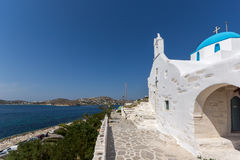Amazing seascape with White chuch with blue roof in town of Parakia, Paros island, Greece Stock Photos