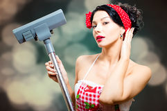 Amazing sexi pin-up lady with vacuum cleaner Stock Images