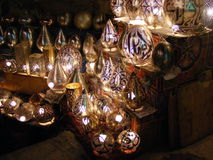 Amazing Shining lanterns in khan el khalili souq market with Arabic handwriting on it in egypt cairo. Vendor selling handmade copper oriental lamps ornaments in Royalty Free Stock Images