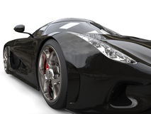 Amazing shiny black supercar - headlight extreme closeup shot Stock Images
