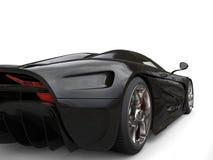 Amazing shiny black supercar - rear wheel closeup Royalty Free Stock Photo