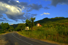 Summer skies mountain road. Dramatic rainy summer sky over Rhodopes mountain road.Picture taken on July 11,2014,Bulgaria royalty free stock photography
