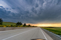 Amazing sky above the long road at sunset Royalty Free Stock Images