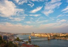Amazing sky with picturesque clouds over Danube river in the central area of Budapest, Hungary. Chain Bridge in the middle and Parliament building on royalty free stock photos