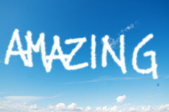 Amazing in the sky. Amazing written in the blue sky royalty free stock image