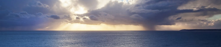 Amazing skyscape panorama with sunset over sea. Stock Photos