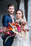 Amazing smiling wedding couple. Pretty bride and stylish groom. Outdoor stock photography