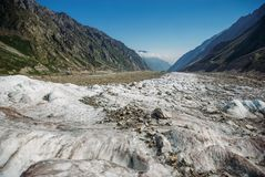 Amazing snowy valley between mountains, Russian Federation, Caucasus,. July 2012 Royalty Free Stock Images