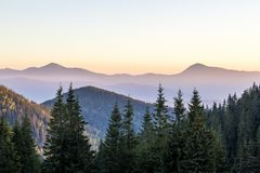 Amazing soft sunset in mountains. Cerpathian mountain peaks and Stock Photos
