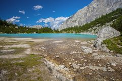 Amazing Sorapis Lake. Amazing view of Sorapis lake with unusual color of water. Lake located in Dolomite Alps, Italy Royalty Free Stock Photography
