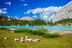Amazing Sorapis lake. Amazing view of Sorapis lake with unusual color of water. Lake located in Dolomite Alps, Italy Royalty Free Stock Image