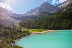 Amazing Sorapis lake. Amazing view of Sorapis lake with unusual color of water. Lake located in Dolomite Alps, Italy royalty free stock photo