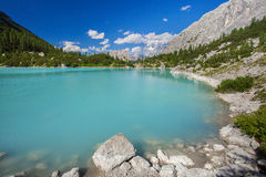 Amazing Sorapis lake. Amazing view of Sorapis lake with unusual color of water. Lake located in Dolomite Alps, Italy Stock Photo