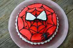 Amazing Spiderman Decorated Cake. An Amazing Spiderman decorated cake with a Spiderman fondant mask and spider with web.  Red, White and Black frosting Royalty Free Stock Images