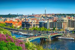 Amazing spring cityscape panorama, Prague, Czech Republic, Europe. Wonderful touristic and travel destination. Vltava river and bridge with red trams. City stock image