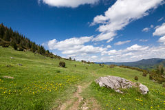 Amazing spring mountain landscape with blue sky and clouds Royalty Free Stock Photos