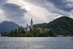 Amazing spring sunrise on Bled lake, Island, Church And Castle with Mountain Range Stol, Vrtaca, Begunjscica. In The Background - Bled, Slovenia, Europe Royalty Free Stock Images