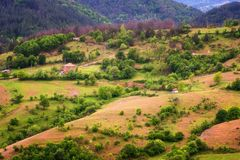 Amazing spring view with a little village in Rhodopi Mountains, Bulgaria. stock photos
