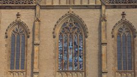Amazing stained glass windows of medieval gothic church in sunny weather. Close-up view stock video footage