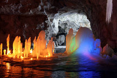 Amazing stalagmite illuminations in cave Stock Images