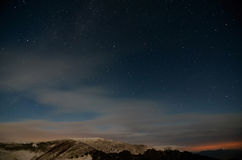Amazing Star Night. Starry cloudy sky in the mountains royalty free stock photos