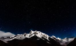 Stars over the mountain peak. This amazing stars constellation over the Swargarohini peak, it is said to be the path to heaven royalty free stock photos