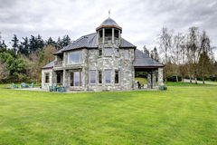 Amazing stone house with a big column porch Stock Photo