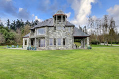 Amazing stone house with a big column porch Royalty Free Stock Photos