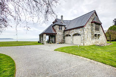 Amazing stone house with column porch and garage Royalty Free Stock Photos