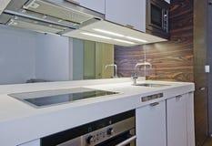 Amazing studio flat kitchen. Amazing luxury studio flat kitchen with modern appliances Royalty Free Stock Photos