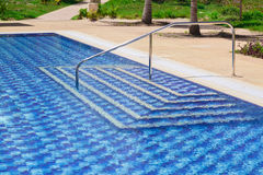 Amazing stylish modern blue ceramic tiles swimming pool entrance Stock Photo