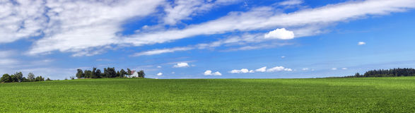 Amazing summer countryside with green pasture and blue sky with clouds - Czech Republic, Europe. Amazing summer countryside with green pasture and blue sky with royalty free stock image