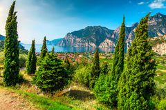 Lake Garda with high mountains on sunny summer day, Italy. Amazing summer holiday destination with lake Garda and high mountains, Torbole, Italy, Europe royalty free stock photos