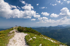 Amazing summer mountains with blue sky and clouds Stock Photos