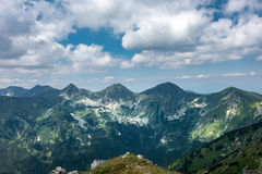 Amazing summer mountains under blue sky with clouds Stock Photos