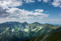 Amazing summer mountains under blue sky with clouds Royalty Free Stock Images