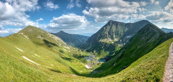 Amazing summer mountains under blue sky with clouds Stock Image