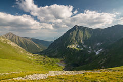 Amazing summer mountains under blue sky with clouds Stock Images