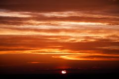 Amazing sun at dusk clouds. sunset image. beautiful red cloudy s. Unset  in orange sky, dramatic view. fascinating wallpaper. beautiful nature moments Stock Image