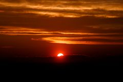 Amazing sun at dusk clouds. sunset image. beautiful red cloudy s. Unset  in orange sky, dramatic view. fascinating wallpaper. beautiful nature moments Royalty Free Stock Images